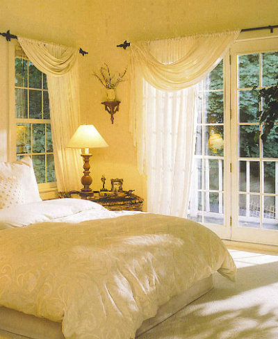 Bedroom window drapes hung over cast-iron rods with French doors, French door window treatments, bedroom window coverings.
